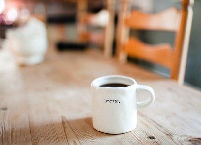 Begin-desk-coffee-work-internship.jpg