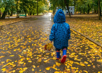 Child in park in wellies
