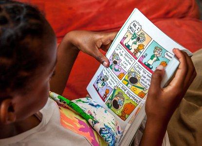 Boy reading a comic