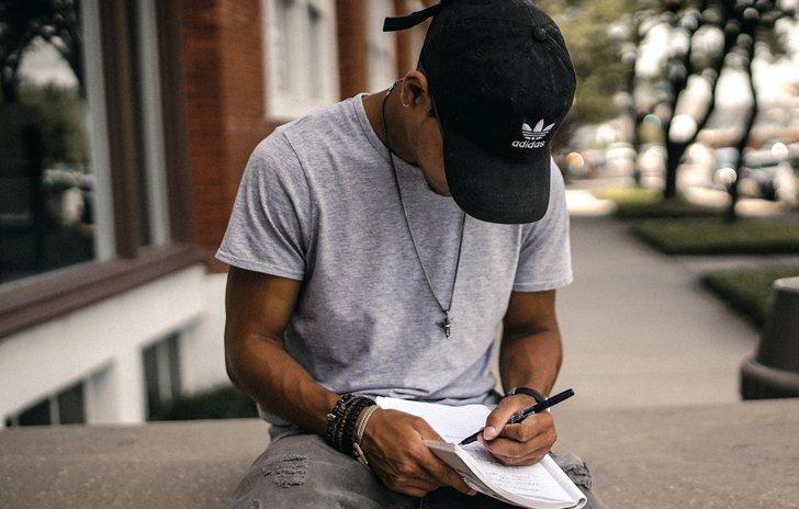 Boy writing in a journal