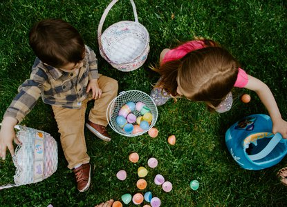 Children sharing Easter eggs