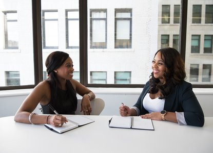 Women having a conversation in the office