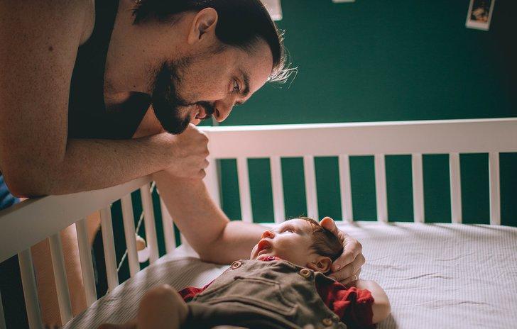 dad putting baby to sleep