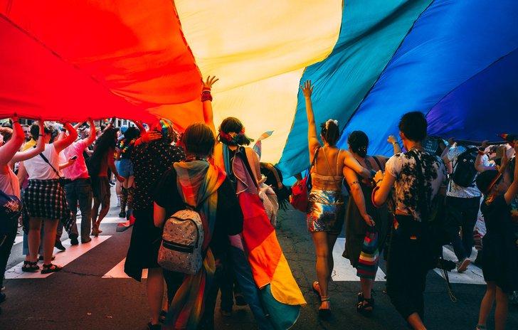 People under a Pride flag