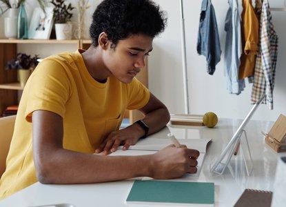 Teenager writing