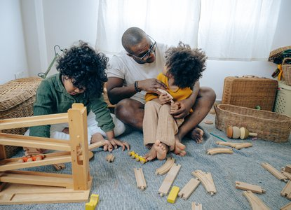 Parent playing with toys with children