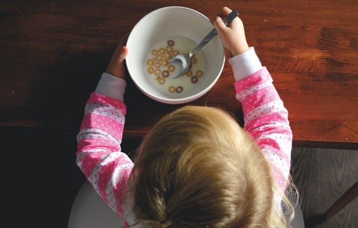 Little girl eating cereal
