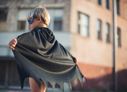 Boy dressed as superhero